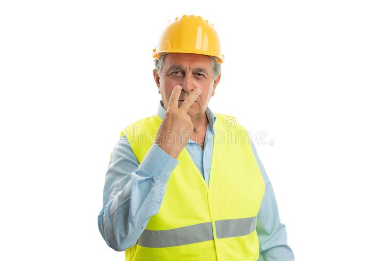 Construction worker pointing fingers at eyes stock images