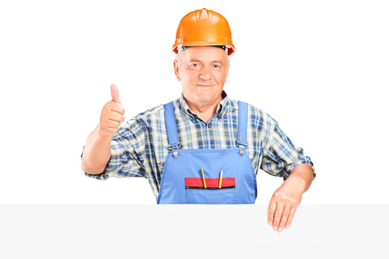 Download Construction Worker Posing Behind A Panel Stock Photo - Image: 27121400