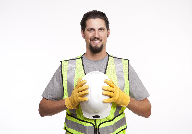 Construction worker posing with a hardhat stock images