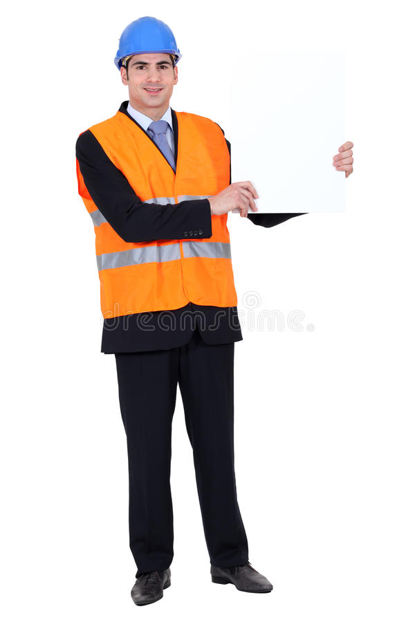 Construction worker with poster stock photo