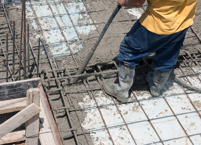 Construction worker pouring concrete stock photo