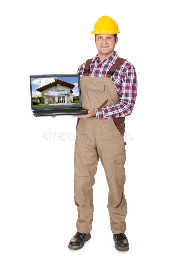 Construction worker presenting laptop. Isolated on white background stock photos