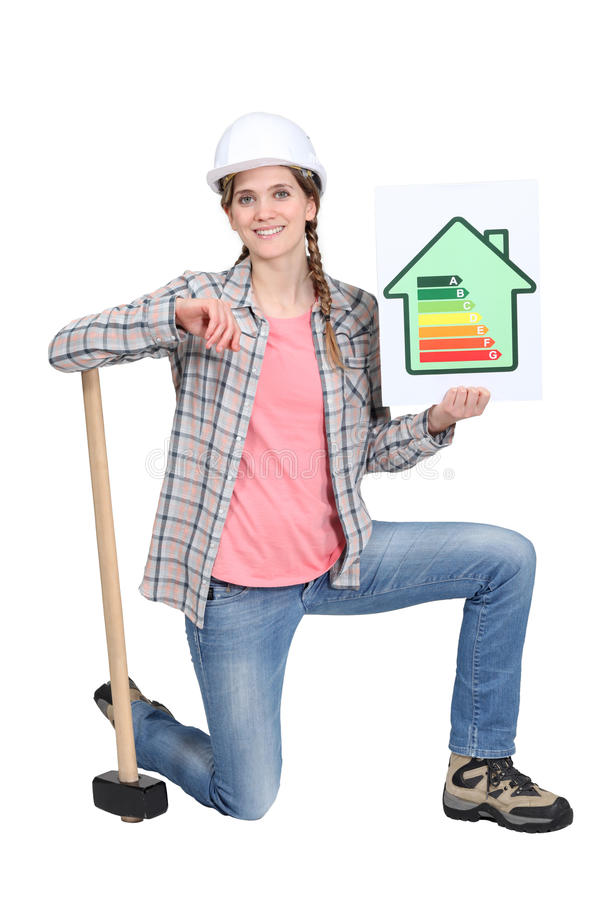 Construction worker promoting energy savings. A female construction worker promoting energy savings stock photo