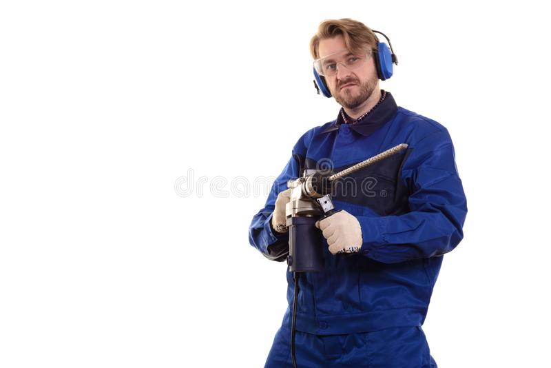 Construction worker in protective glasses and headphones with a puncher on a white background stock images
