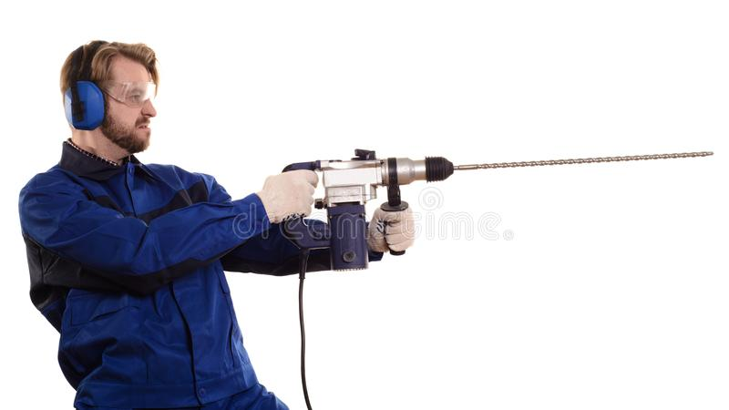 Construction worker with a puncher stands sideways on a white background stock image
