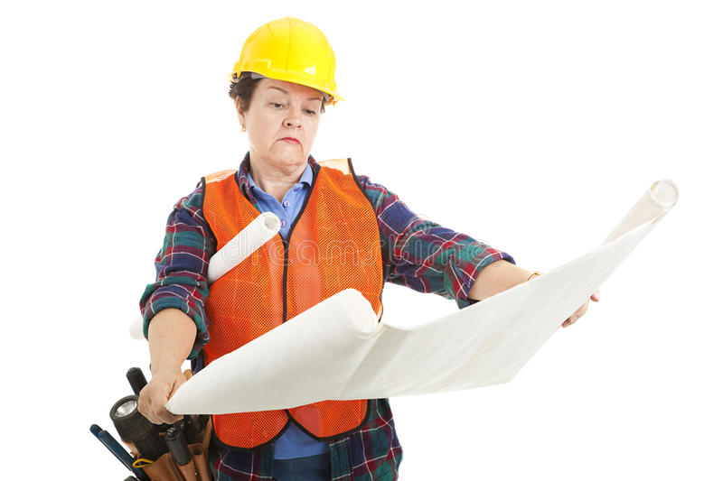 Construction Worker Reads Plans stock photos