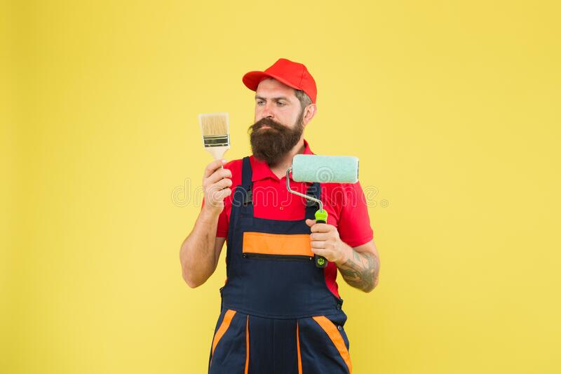 Construction worker ready to work. brutal hipster try to be craftsman. professional repairer. serious builder man stock photography