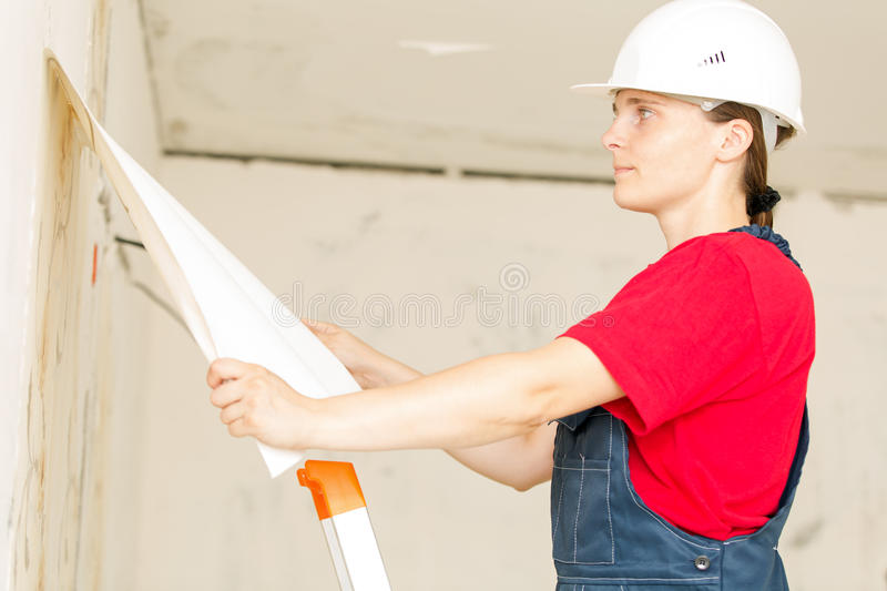 Construction worker removing wallpaper royalty free stock photos