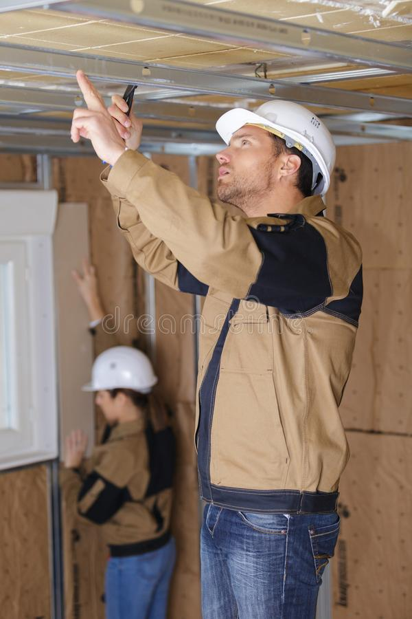 Construction worker renovating apartment house. Workers stock photography