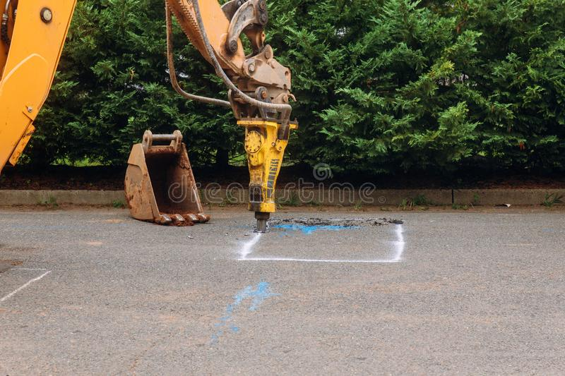 Construction worker repairing road with Jackhammer stock photo