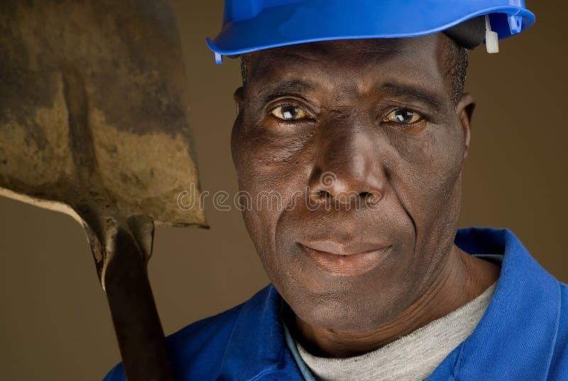 Construction Worker Resting Shovel on Shoulder stock image