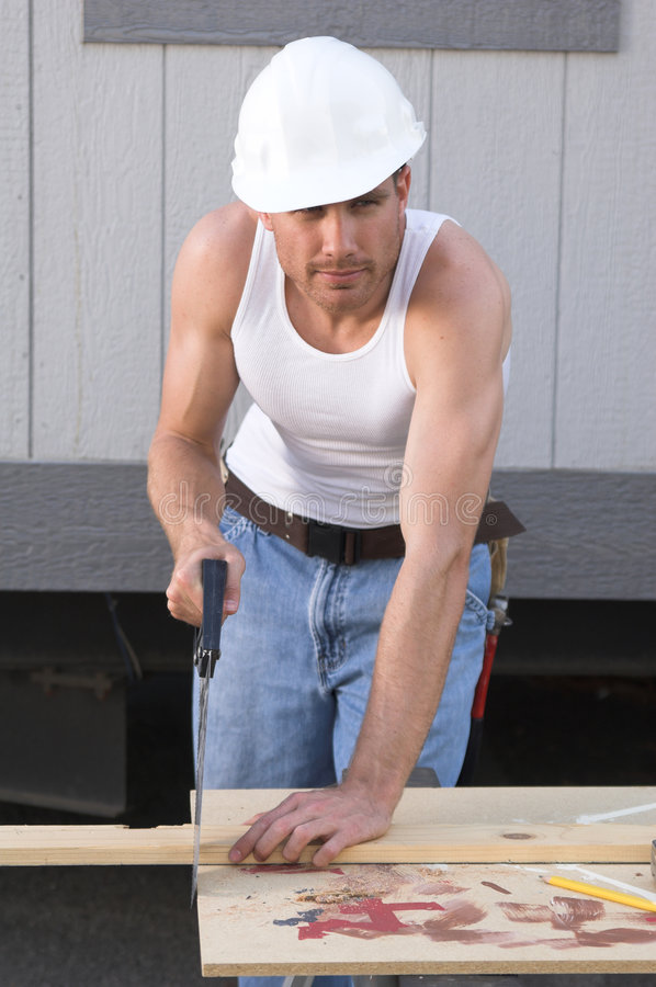 Construction worker and saw stock image