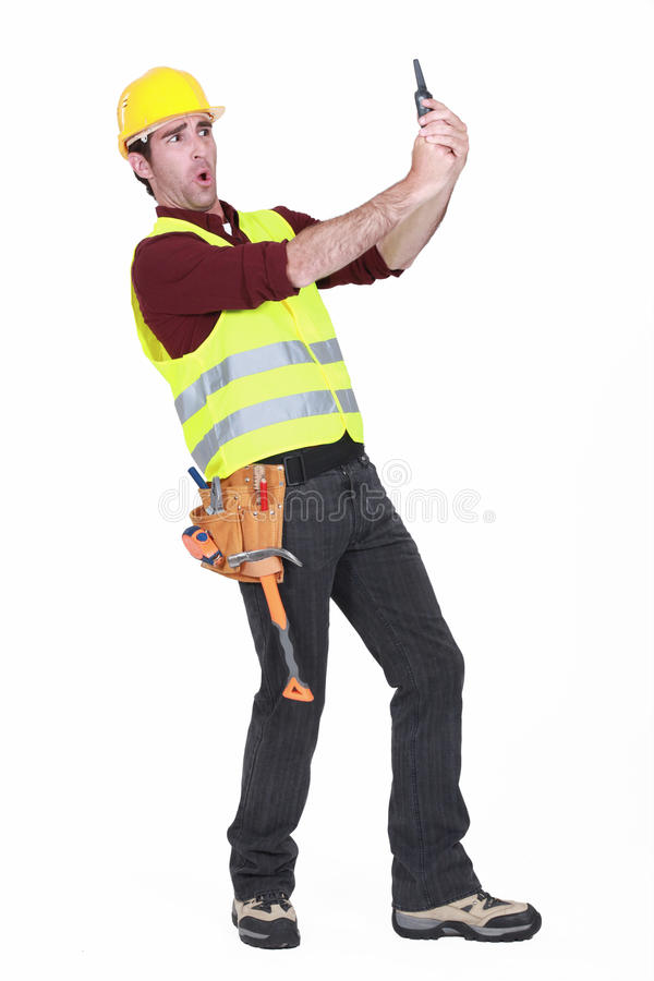 Construction worker shocked. At his walky talky royalty free stock images