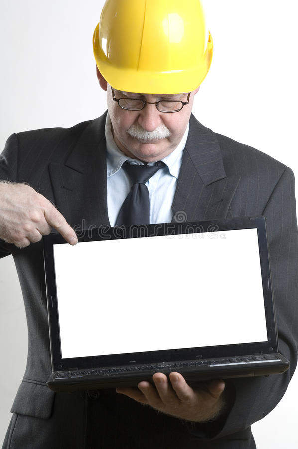 Construction worker showing laptop royalty free stock image