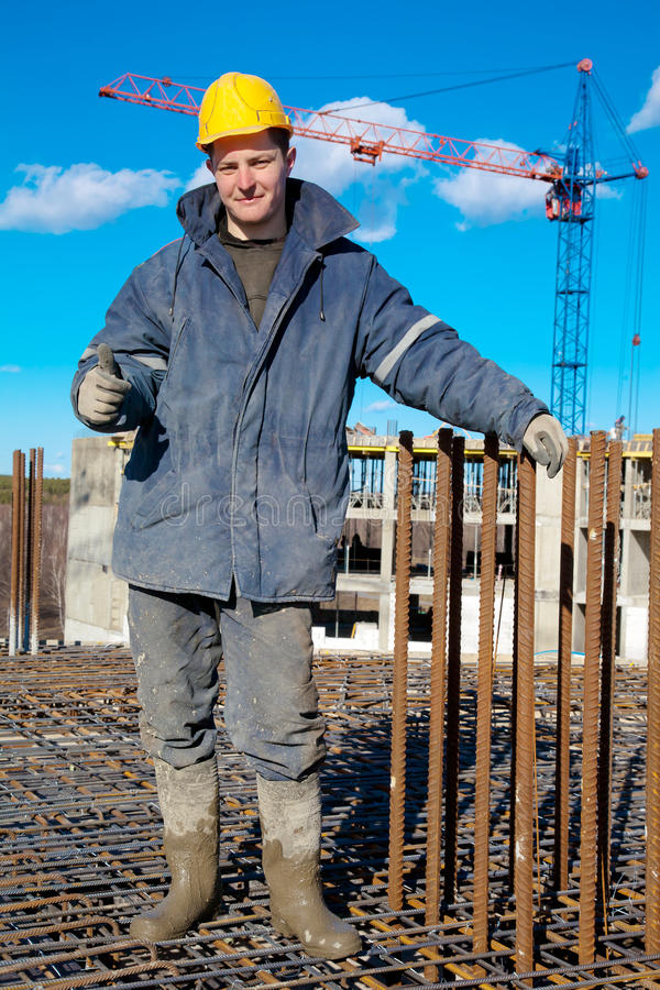 Construction worker showing a thumb up stock image