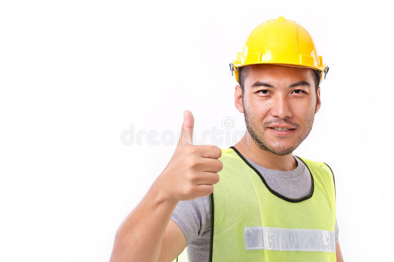 Construction worker showing thumb up gesture royalty free stock photo