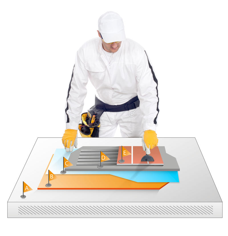 Construction worker shows how tiles are glued stock photo