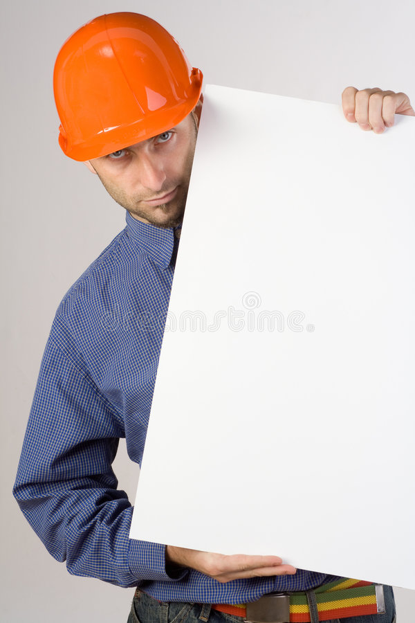 Construction worker with sign. Construction worker with blank white sign royalty free stock photo