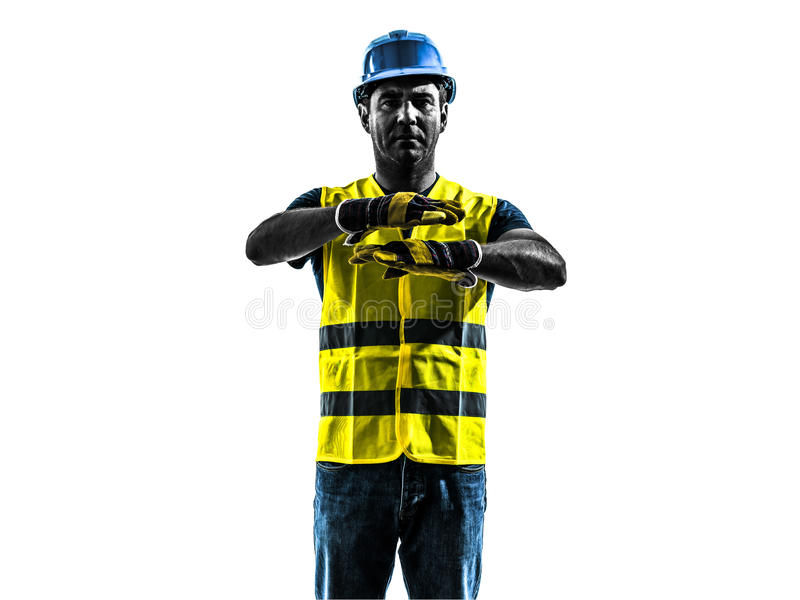Construction worker signaling safety vest emergency stop silhouette. One construction worker signaling with safety vest emergency stop silhouette isolated in stock photography