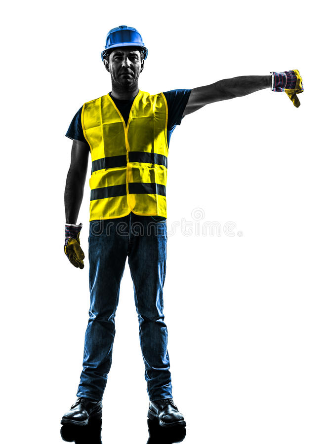 Construction worker signaling safety vest lower boom silhouette. One construction worker signaling with safety vest lower boom silhouette isolated in white royalty free stock images