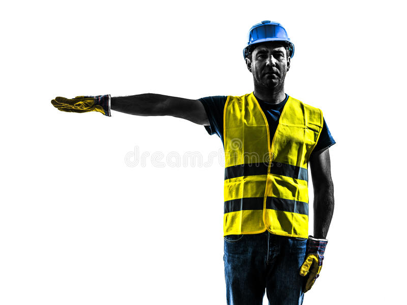 Construction worker signaling safety vest silhouette. One construction worker signaling with safety vest silhouette isolated in white background stock photos