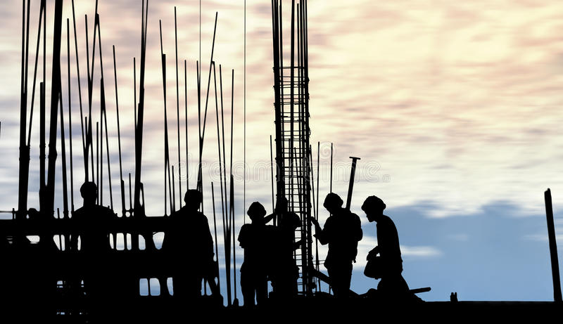 Construction worker silhouette on the work place royalty free stock photos