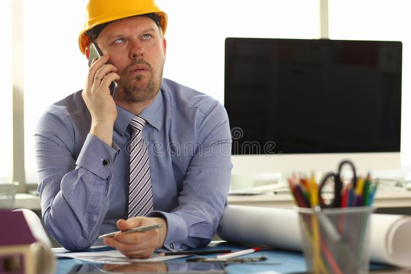 Construction Worker Sit in Engineering Office stock photography