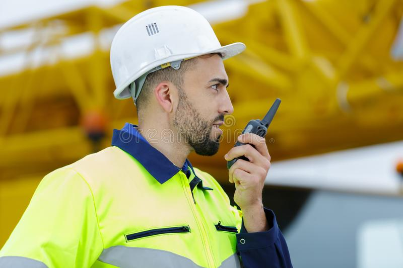 Construction worker on site using walkie talkie stock photos