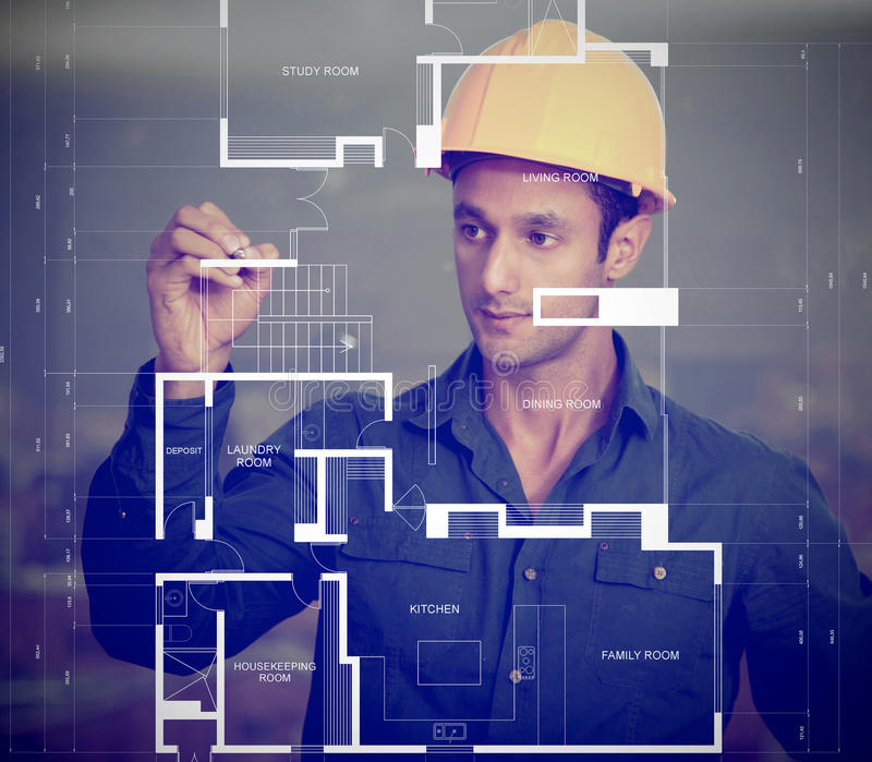 Download Construction Worker Sketching Blueprints Stock Image - Image: 24792395