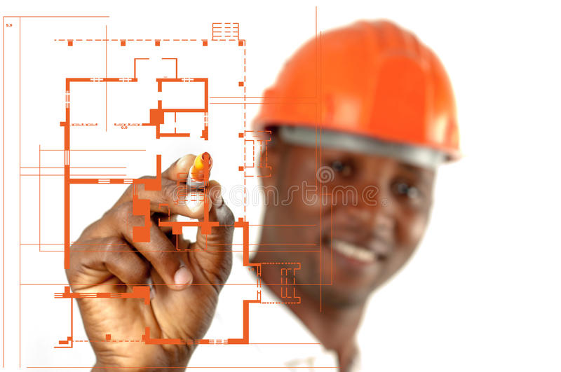 Construction Worker Sketching Blueprints. African American Construction worker wearing helmet sketching blueprints royalty free stock photos