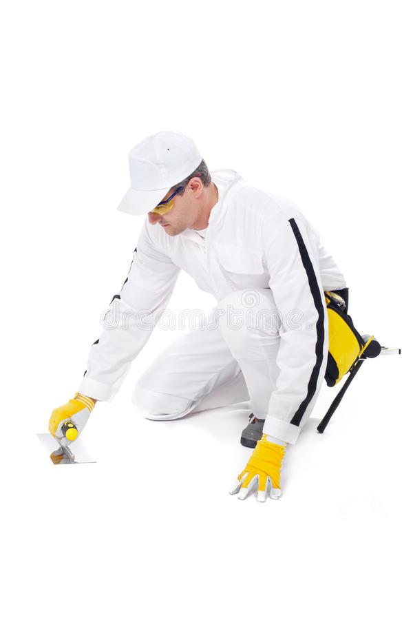 Construction worker smooths with trowel floor royalty free stock photos