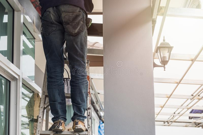 Construction worker standing on aluminium stairs royalty free stock images