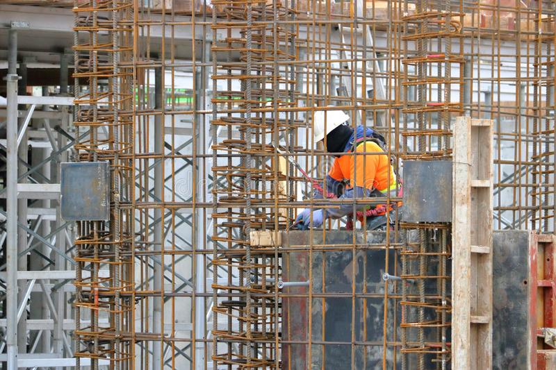 Construction Worker Encaged in Re-bar stock images