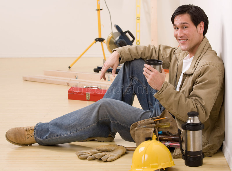 Construction worker taking a coffee break stock photography