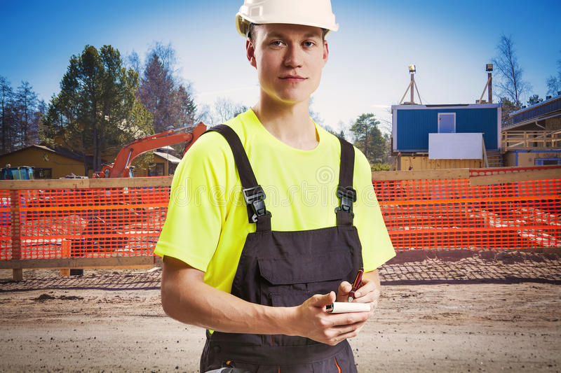 Construction worker taking notes stock image