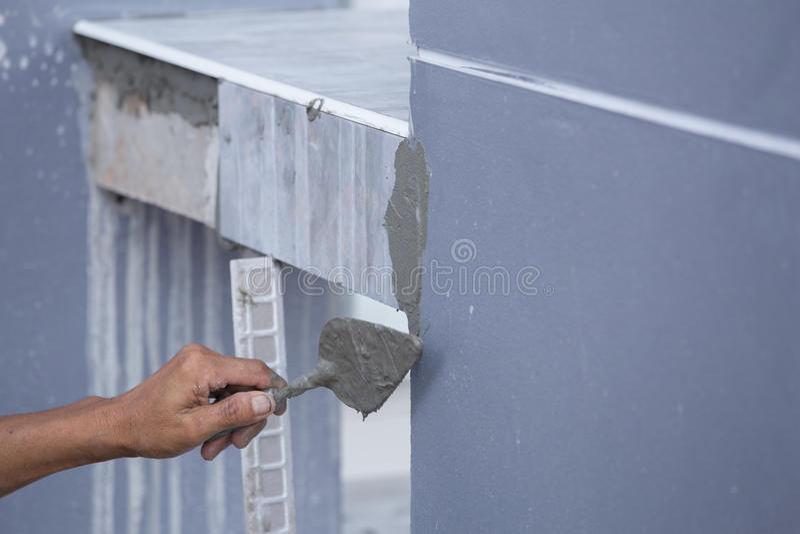 Construction worker tiler is tiling, ceramic tile floor, trowel stock photos