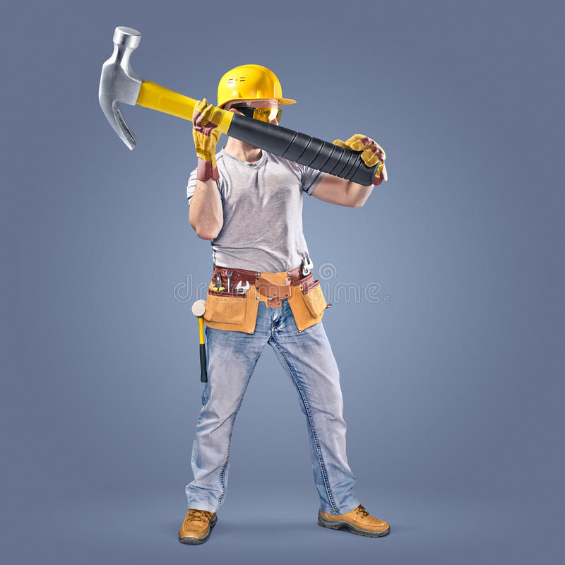 Construction worker with a tool belt and a hammer stock image