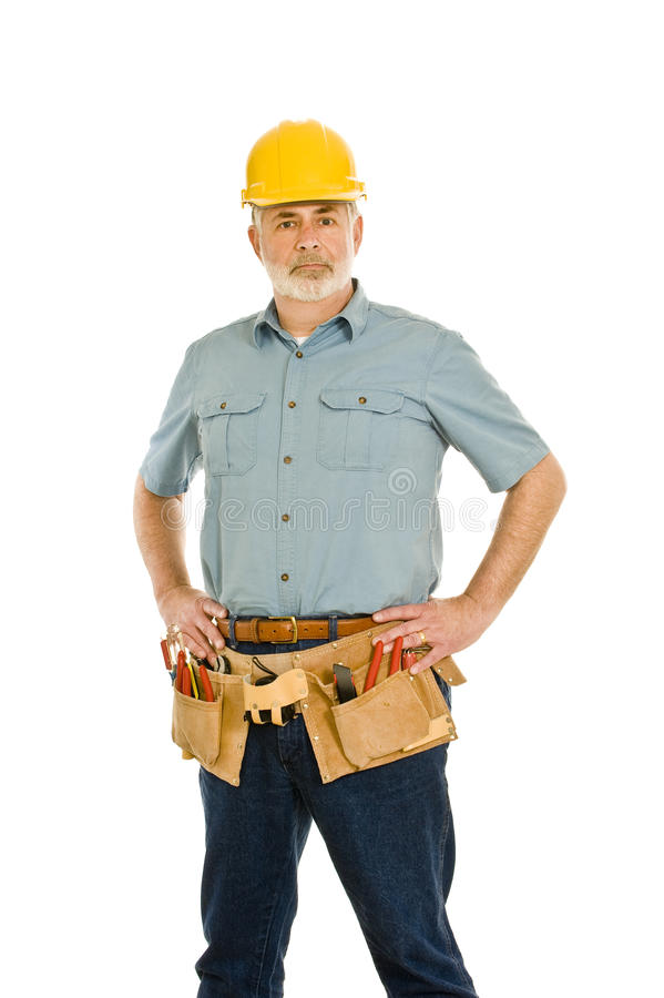 Construction Worker With Toolbelt And Hardhat Standing Tall stock images