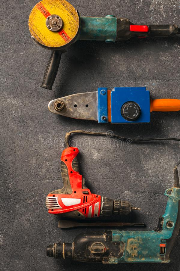 Construction worker tools on dark background top view stock images