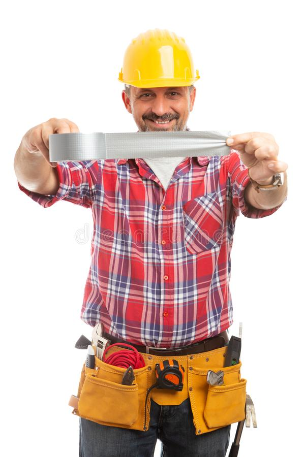 Construction worker unsticking duct tape stock photo
