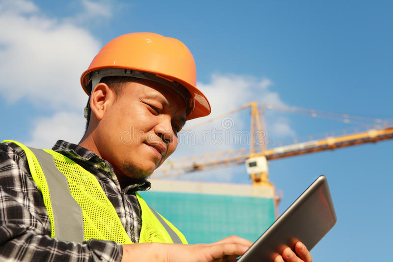 Construction worker using digital tablet royalty free stock photos