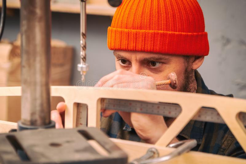 Construction Worker. Using Drill To wood. Drill machine on the table in renovation work at home. Home repair concepts, close up royalty free stock image