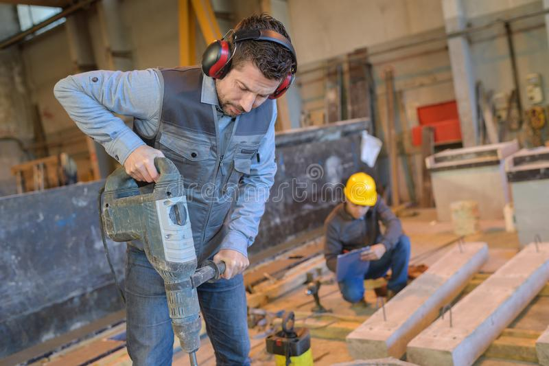 Construction worker using hammer drill royalty free stock photos