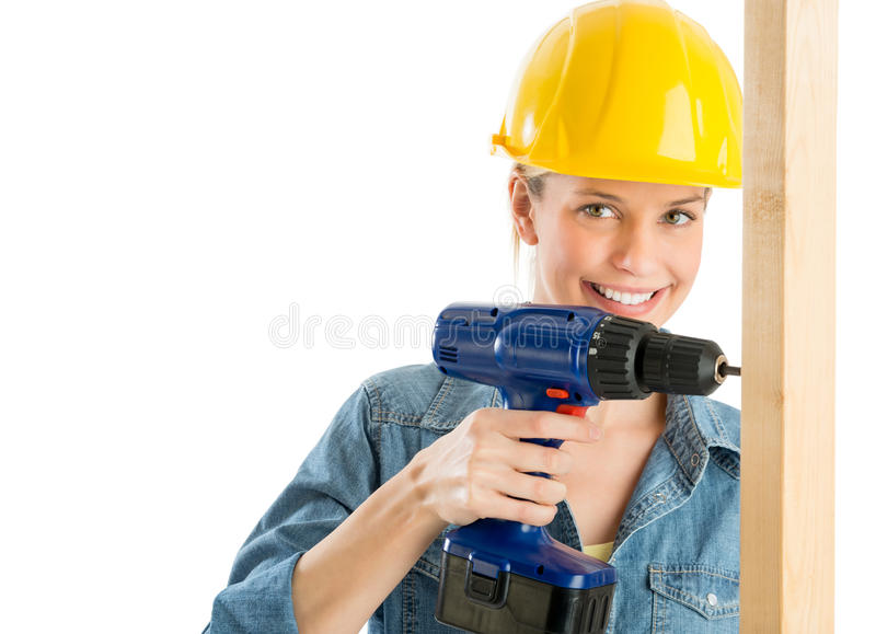 Download Construction Worker Using Power Drill On Wooden Plank Royalty Free Stock Image - Image: 32145736