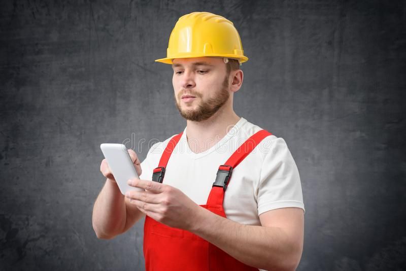 Construction worker using smartphone stock images