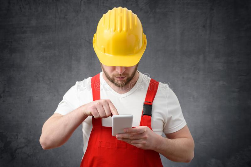 Construction worker using smartphone stock photography