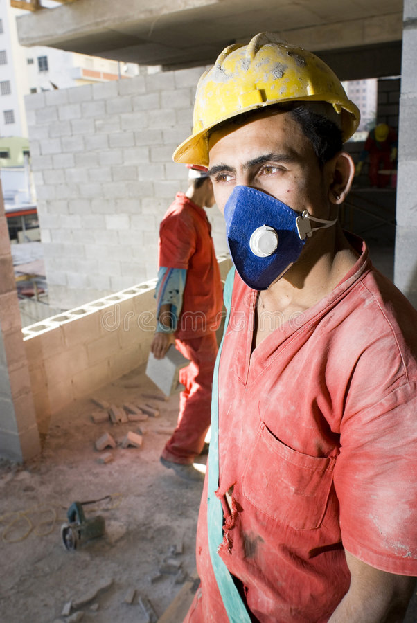 Construction Worker Wearing Mask - Vertical royalty free stock images