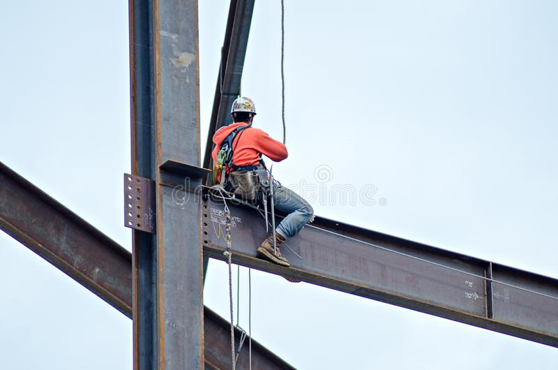 Construction worker working on highrise building royalty free stock photos