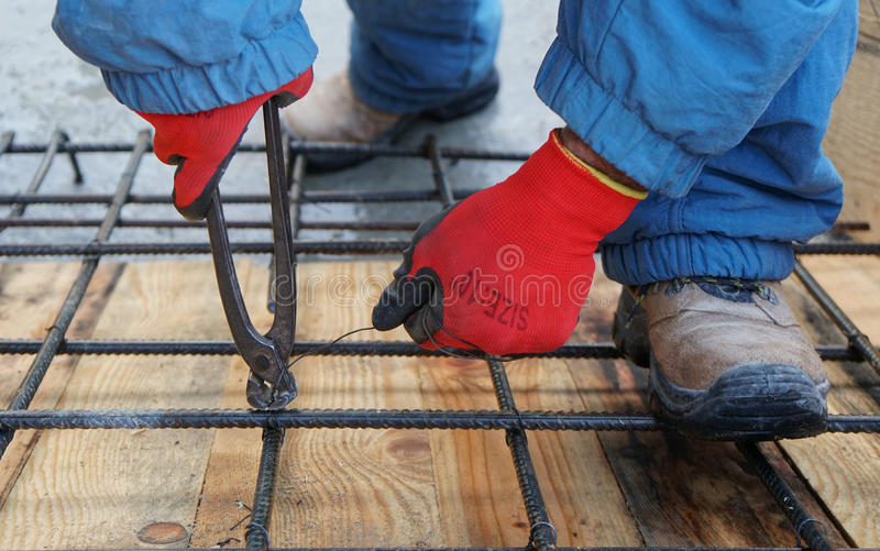 Construction worker working on steel rods. Used to reinforce concrete royalty free stock image