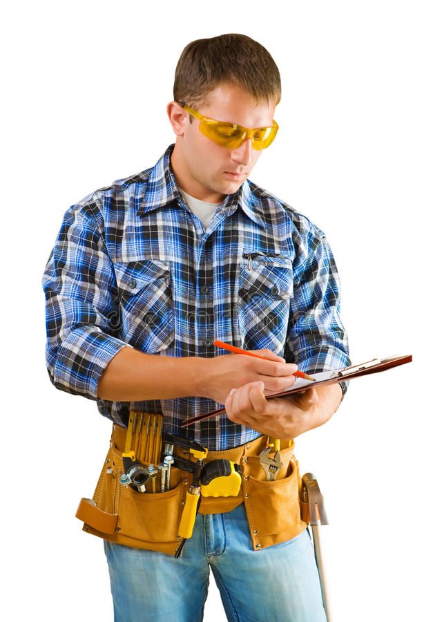 Construction worker writing in paperclip stock photo